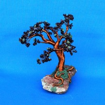 wire-tree-sculpture-with-garnet-and-peridote